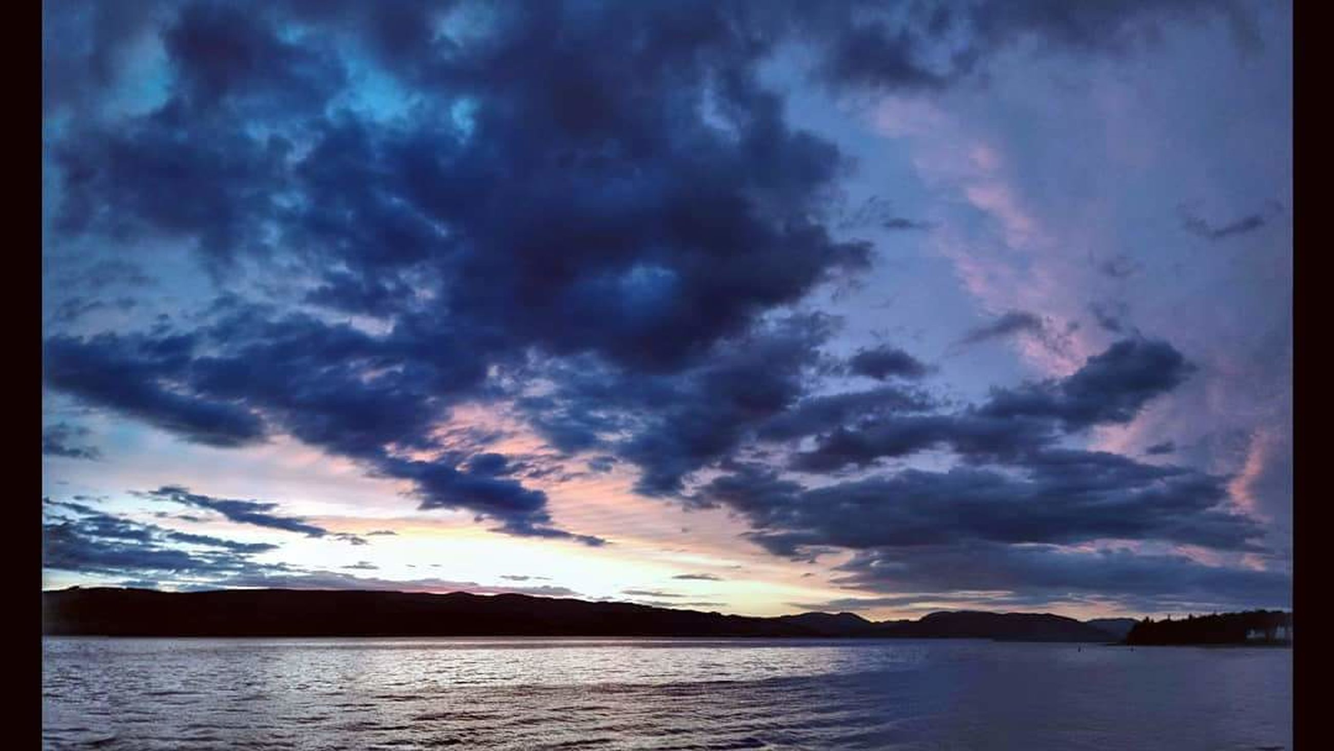 sky, cloud - sky, water, scenics - nature, beauty in nature, sunset, tranquil scene, tranquility, sea, dramatic sky, mountain, nature, no people, idyllic, cloudscape, storm, moody sky, silhouette, outdoors, dark