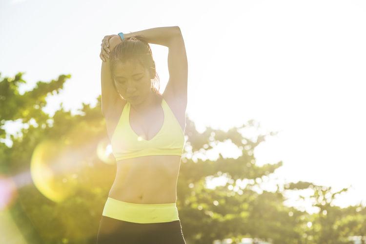 Mature Woman Exercising At Park