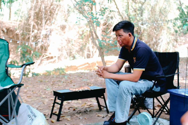 Full length of man sitting on chair