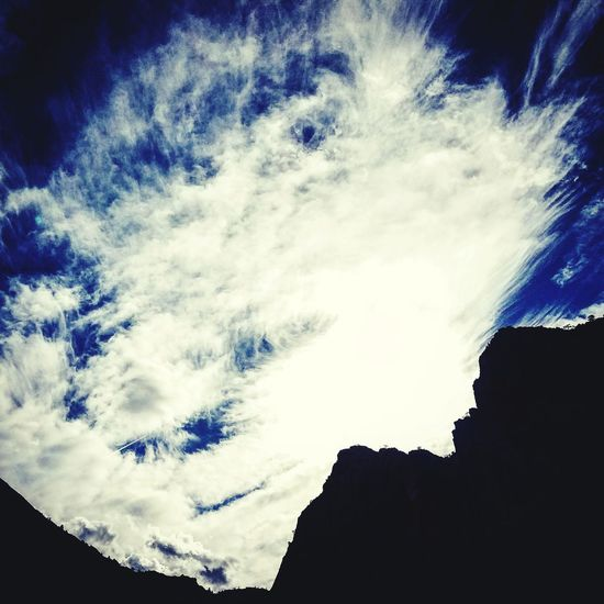 Clouds and sky Low Angle View Silhouette Sky Scenics Tranquility Beauty In Nature Tranquil Scene Mountain Nature Cloud - Sky Cloud Cliff Day Outdoors Majestic Outline High Section Non-urban Scene No People Cloudy EyeEmNewHere