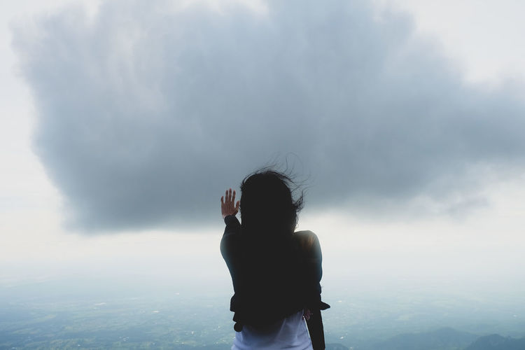 One Person Real People Sky Standing Rear View Cloud - Sky Lifestyles Beauty In Nature Leisure Activity Nature Three Quarter Length Tranquil Scene Fog Tranquility Scenics - Nature Adult Idyllic Day Outdoors Arms Raised