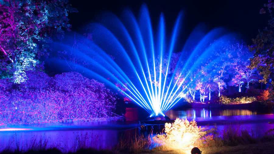 Illuminated blue water at night