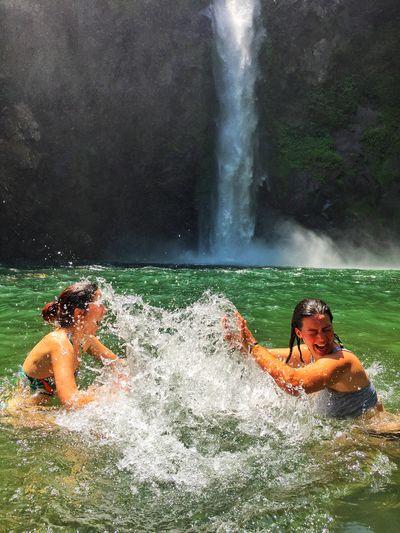 Pool splash Waterfall Splash Pool Water Splashing Motion Spraying People Two People Outdoors