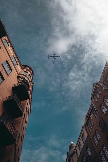Architecture Built Structure Building Exterior Low Angle View Sky Cloud - Sky Nature Transportation Mode Of Transportation Tall - High Travel City Skyscraper Building Airplane Outdoors Air Vehicle Flying No People Day My Best Photo The Architect - 2019 EyeEm Awards The Street Photographer - 2019 EyeEm Awards