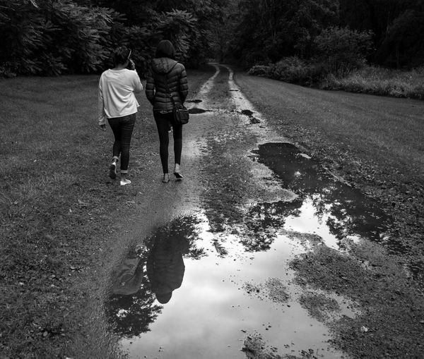 Blackandwhite Day Full Length Leisure Activity Monochrome Nature Outdoors Real People Rear View Standing Togetherness Tree Two People Walking Water Women