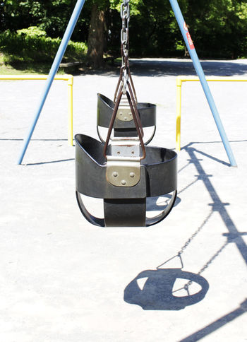 Beauty In Nature Childhood Day Mountain Outdoors Playground Equipment Shadow Sunny Swing Yellow Yellow Flower