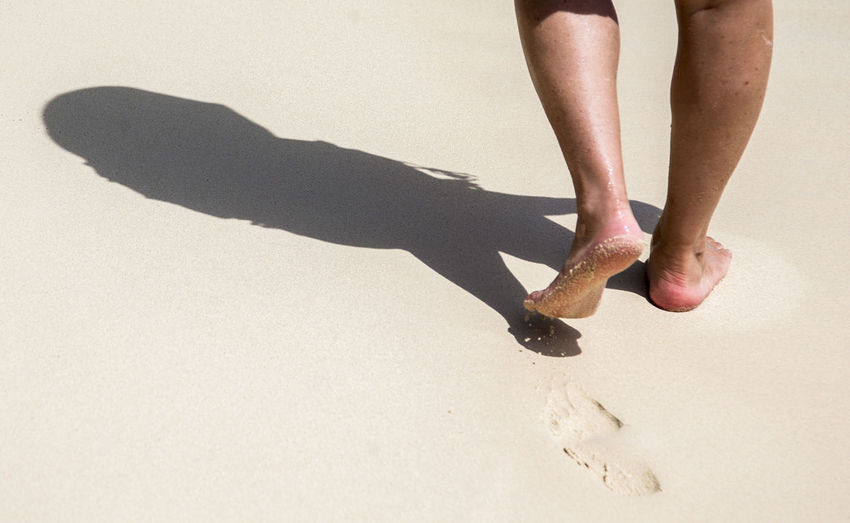 Beach walker Adult barefoot Barefoot Beach Barefoot Lifestyle Body Part Cayman Islands Hiker Human Body Part Human Foot Human Leg Human Limb Land Lifestyles Low Section Nature On The Beach One Person Real People Sand Seven Mile Beach Shadow Walking On The Beach Women