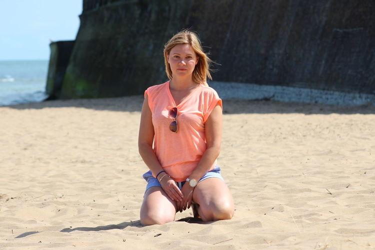 Full length of man sitting on beach