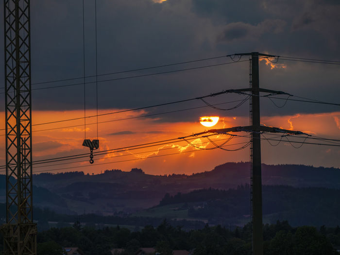 Rising Sun Burning Sky Sunlight Sunset_collection Beauty In Nature Beauty In Nature Cable Cloud - Sky Connection Electricity  Electricity Pylon Mountain Nature No People Orange Color Outdoors Silhouette Sky Sun Sundown Sunset Tranquil Scene HUAWEI Photo Award: After Dark A New Beginning My Best Photo