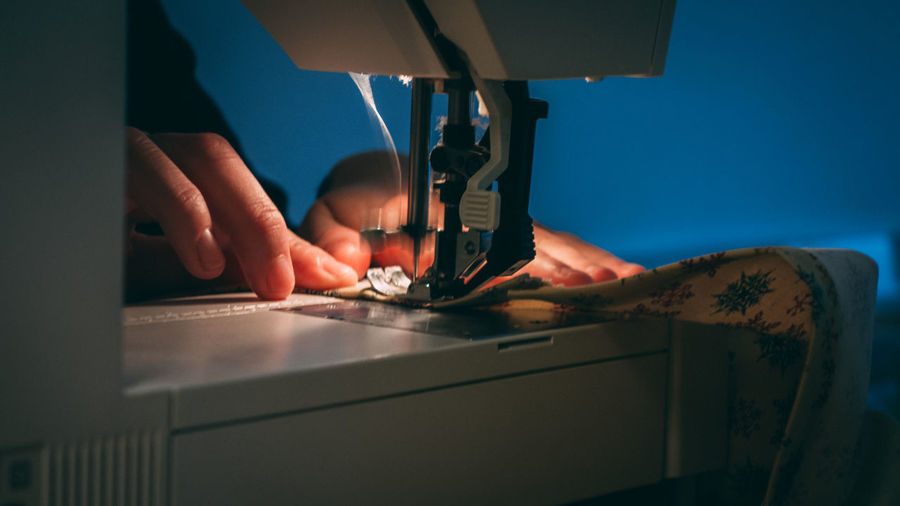 Close-Up Of Man Working On Sewing Machine