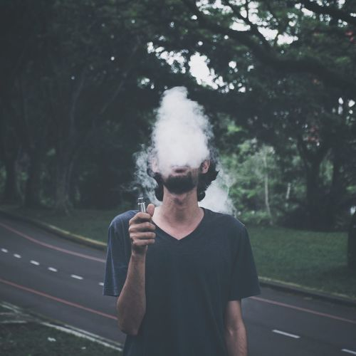 Bad Habit Real People Smoking Issues Smoke - Physical Structure One Person Addiction Road Casual Clothing Front View Lifestyles Outdoors Leisure Activity Transportation Street Day RISK Tree Young Adult Social Issues Young Men EyeEm Ready