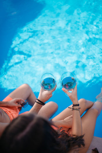 Low section of people by swimming pool
