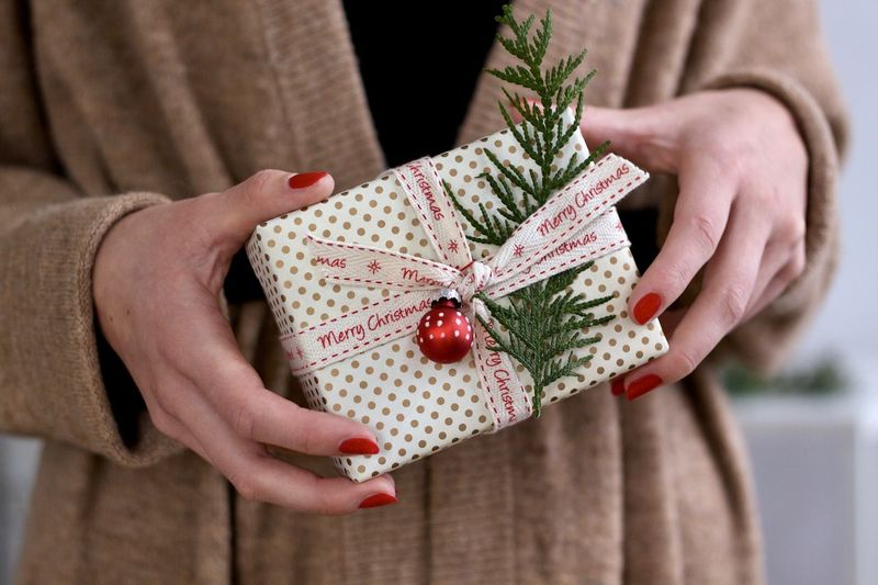 Midsection of woman holding christmas present