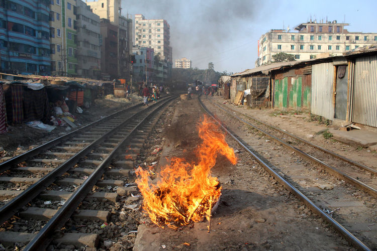Architecture Rail Transportation Building Exterior Railroad Track Track Built Structure Smoke - Physical Structure Fire Burning Transportation City Heat - Temperature Nature Day Flame Mode Of Transportation Outdoors Fire - Natural Phenomenon Building Pollution No People Slum City Lifestyles