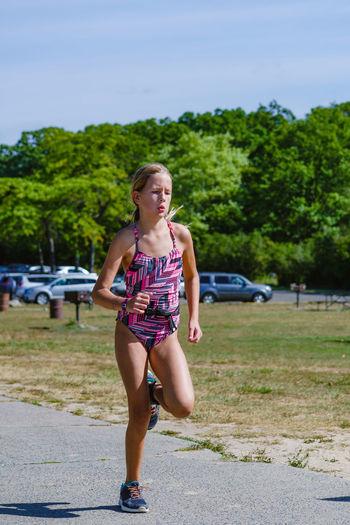 Teenage Girl Running In Swimwear During Triathlon