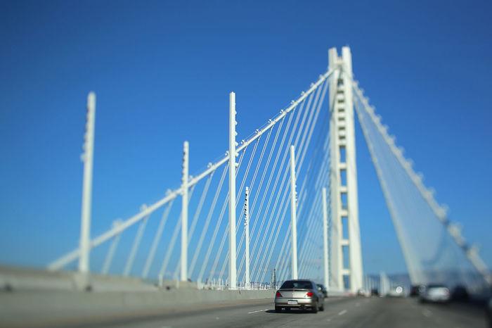 San Francisco-Oakland Bay Bridge Architecture Blue Bridge - Man Made Structure Built Structure Car Clear Sky Connection Day Engineering No People Oakland Bay Bridge Outdoors Road Sky Suspension Bridge Transportation