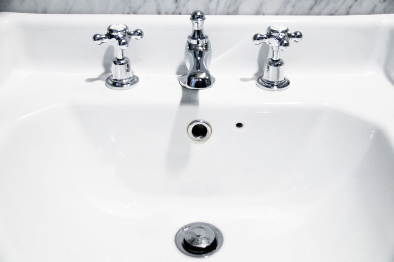High Angle View Of Faucets On Sink In Bathroom