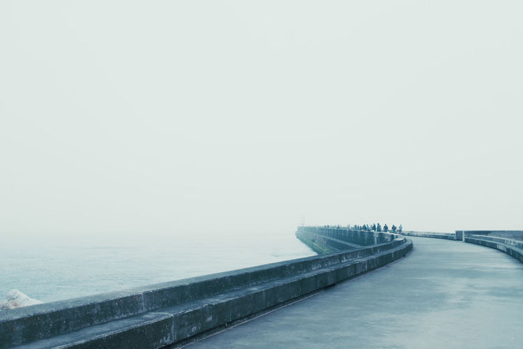 The Sea Threeweeksgalicia Sea Water Nature Sky Outdoors Transportation Architecture No People Copy Space Built Structure Bridge Day Connection Tranquility Tranquil Scene Scenics - Nature Beauty In Nature Fog Bridge - Man Made Structure