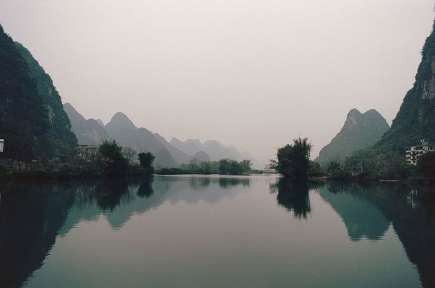 Beauty In Nature Calm Mountain Mountain Range Reflection Sky Standing Water Tranquility