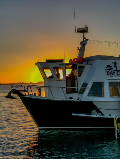 A day trip on the MV Bay Explorer Reflection Silhouette Anchor Beauty In Nature Early Morning Fishing Industry Idyllic Mode Of Transportation Moored Nature Nautical Vessel No People Orange Color Outdoors Scenics - Nature Sea Sky Sunrise Tranquility Transportation Water Waterfront