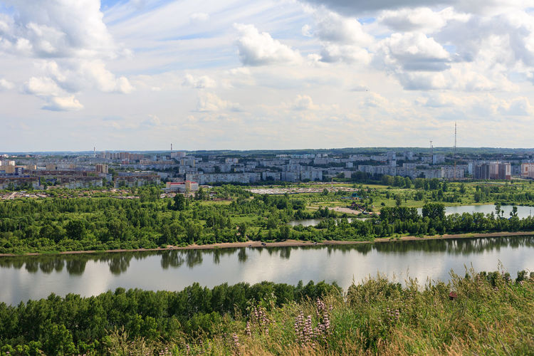 River Tom, Krasnoe lake, and Leninsky district of Kemerovo city. Architecture Cityscape Cloud - Sky Day Environment Growth High Angle View Kemerovo Lake Landscape No People Outdoors Reflection River Siberia Sky Tranquil Scene Tranquility Water