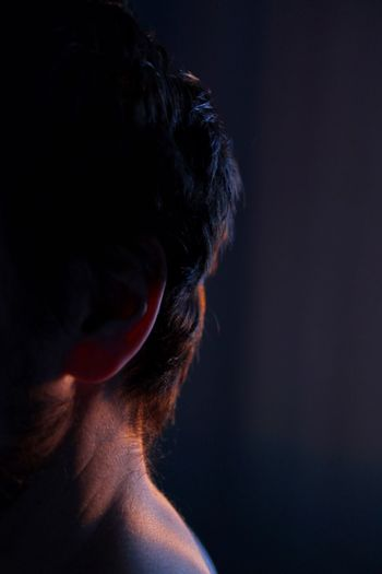 Close-up of woman head against black background