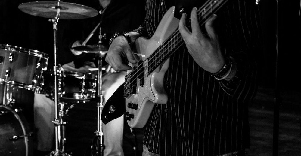 Tilt image of playing guitar at night