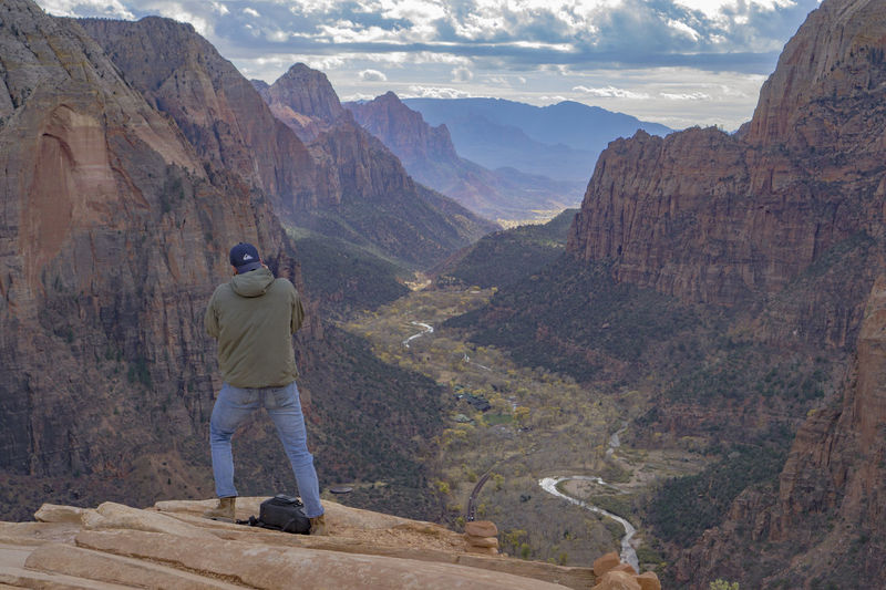 Capturing The Moment Lookout Outlook Stunning Vista Zion National Park Adventure Beauty In Nature Casual Clothing Cliff Expanse Fall Lifestyles Mountain Nature One Man Only One Person Outdoors Photographer Rear View Red Rocks  Sky Standing Valley Viewpoint Go Higher