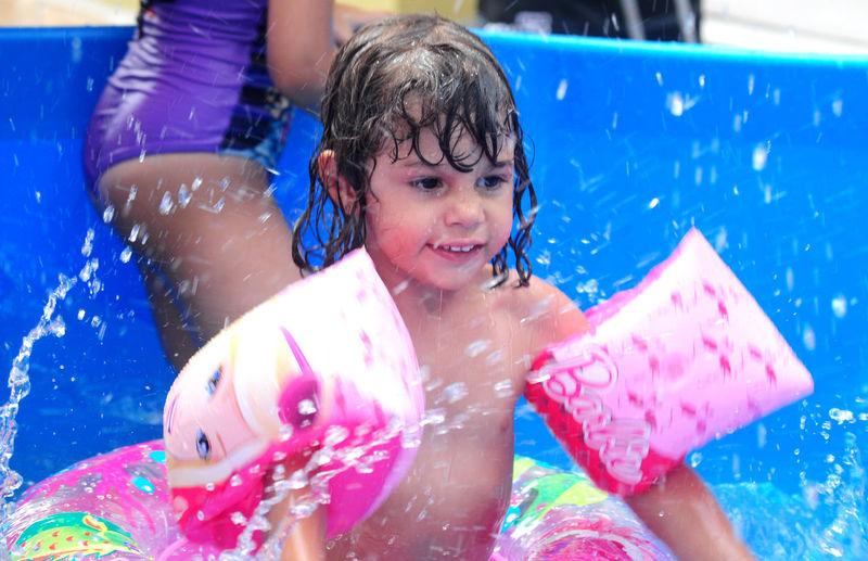 Shirtless Girl Enjoying In Wading Pool