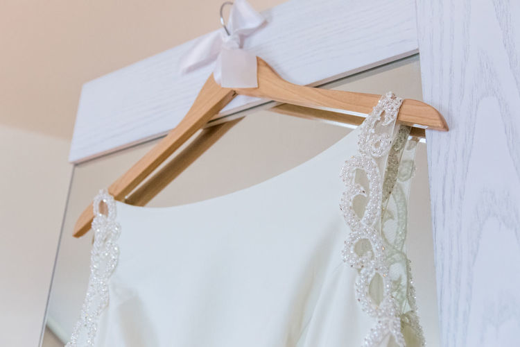 Bathroom Celebration Clean Close-up Clothing Coathanger Domestic Bathroom Domestic Life Dress Event Fashion Focus On Foreground Hanging Home Interior Indoors  No People Silver Colored Textile Wall - Building Feature Wedding White Color Wood - Material