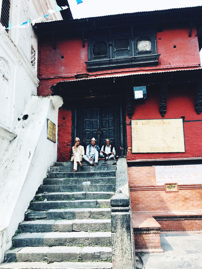 People on staircase of building
