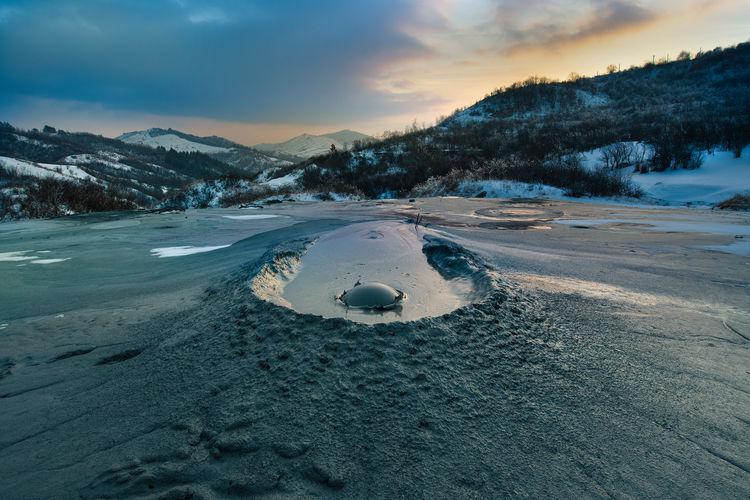 Muddy Volcanoes Mud Volcanoes Vulcano Vulcanic Landscape No People Idyllic Frozen Sunset Landscape Environment Nature Beauty In Nature Cold Temperature Snow Winter Vulcaniinoroiosi Vulcanii Noroiosi