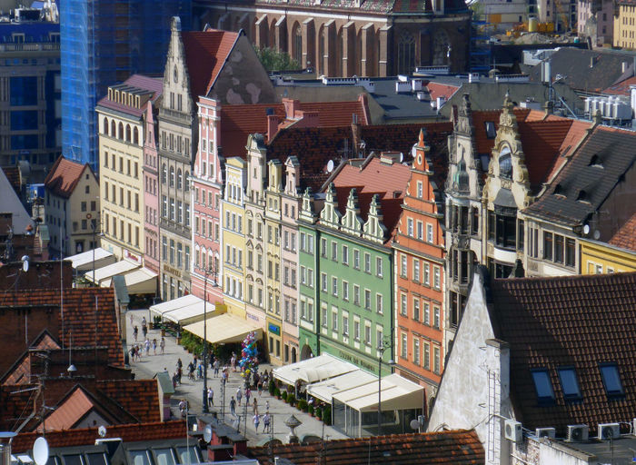 The Rynek in Wroclaw. Colors Poland Travel Wroclaw, Poland Apartment Architecture Building Building Exterior Built Structure City City Life Cityscape Colorful Europe High Angle View Incidental People Marketplace Outdoors Places Residential District Roof Street Tourism Town Travel Destinations Summer In The City My Best Travel Photo The Art Of Street Photography