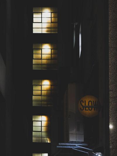 Illuminated sign on wall