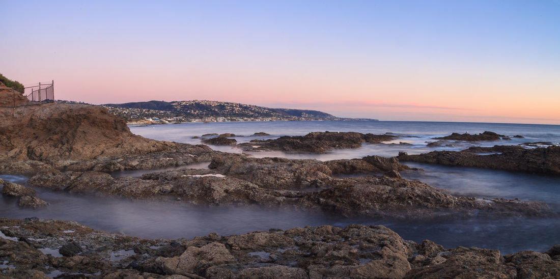 Long exposure of sunset over rocks, giving a mist like effect over ocean in Laguna Beach, California, United States Beach California Day Laguna Beach Landscape Long Exposure Nature No People Outdoors Scenics Sea Sky Sunset Sunsets Water Flow