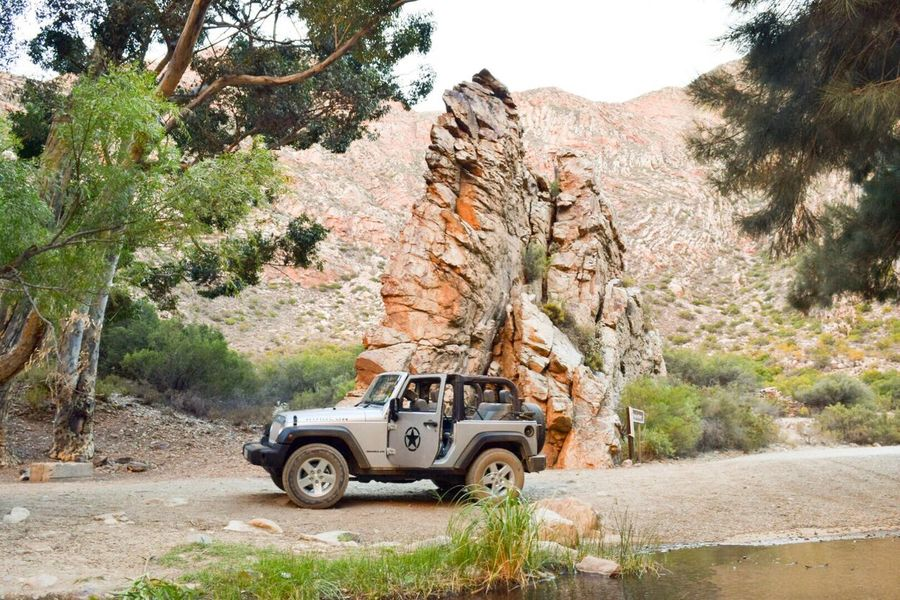 Jeep Wrangler  Swartberg Pass The Karoo Wanderlust Rock - Object 4x4 Rock Formation Adventure Off-road Vehicle Nature Beauty In Nature Our Wrangler. Best car to drive around in the Karoo EyeEmNewHere. The Great Outdoors - 2017 EyeEm Awards
