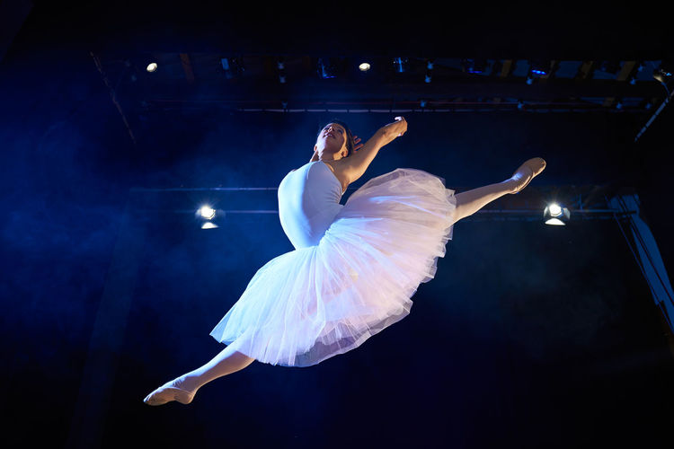 Low angle view of woman dancing on stage