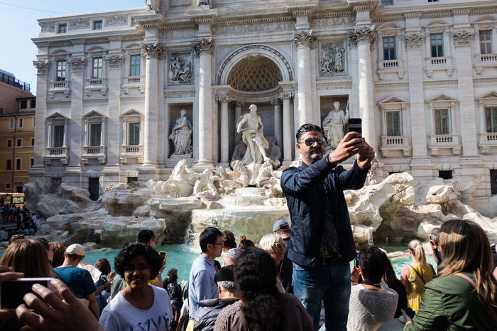 La dolce vita Architecture Building Exterior Built Structure Crowd Fontana Di Trevi La Dolce Vita Large Group Of People Mobile Phone Outdoors People Photographing Photography Themes Real People Rome Selfie Selfie Moment Tourism Travel Destinations Vacations Wireless Technology The Street Photographer - 2017 EyeEm Awards BYOPaper! Live For The Story The Traveler - 2018 EyeEm Awards The Street Photographer - 2018 EyeEm Awards