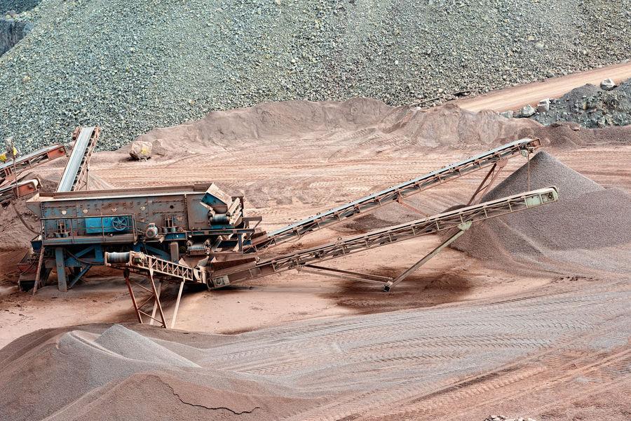 stone crusher machine in a quarry. open mine pit. mining industry Mine Steinbrecher Mining Industry Mining Quarry Stone Crusher Steinbruch Machinery Open Pit Mine Industry Transportation Conveyor Belt Conveyor Belt Machine
