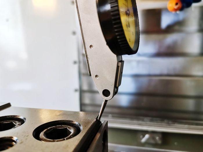 Close-up of machine part vice dial indicator precision