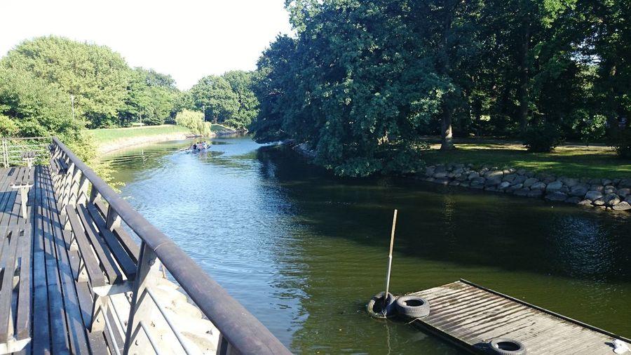 Tree Water Nautical Vessel River Sky Footbridge Coast Bridge Canal Stream Boat Arch Bridge