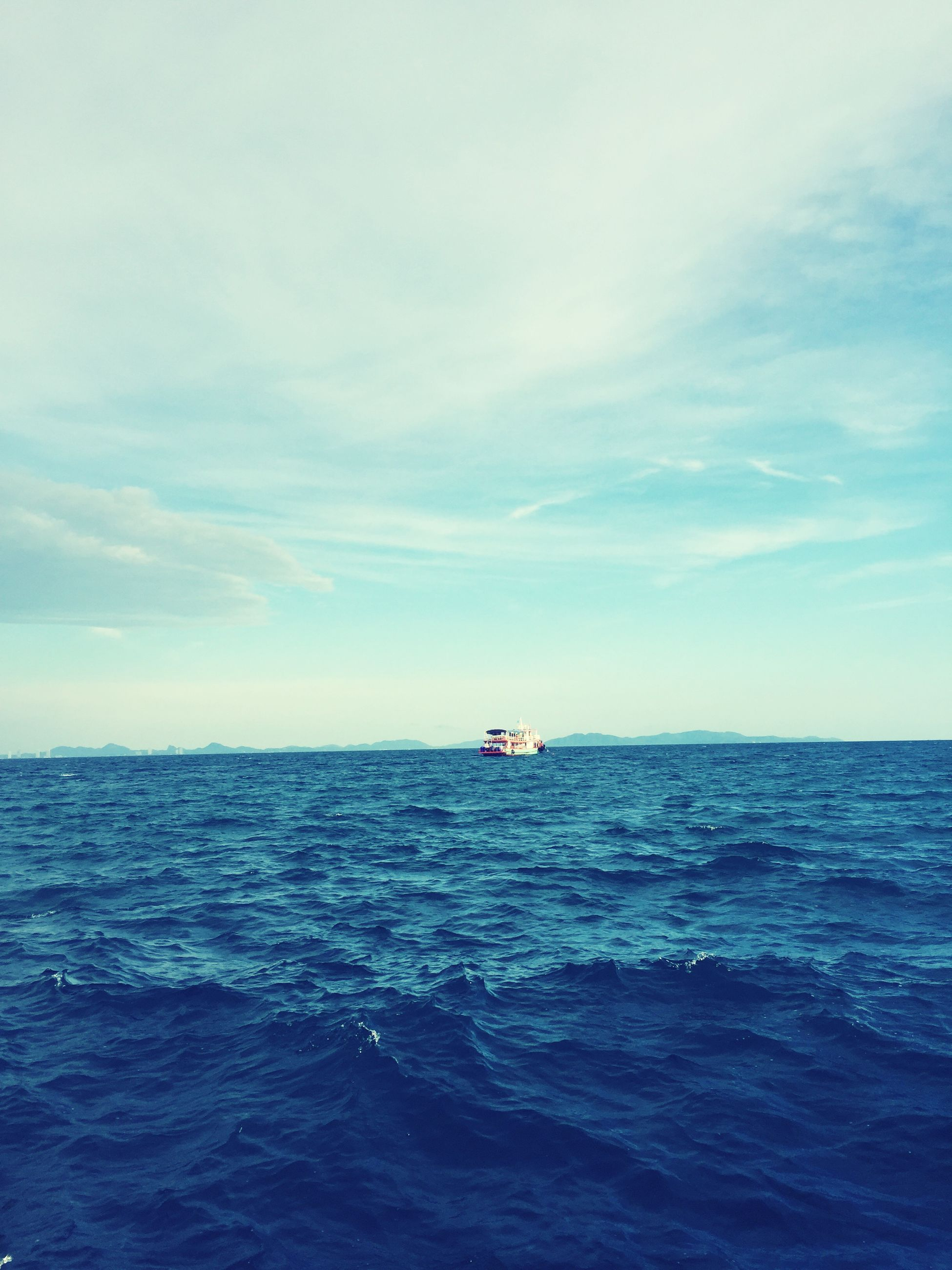 sea, water, horizon over water, waterfront, nautical vessel, transportation, mode of transport, sky, boat, sailing, rippled, blue, scenics, tranquil scene, beauty in nature, tranquility, nature, seascape, cloud - sky, day