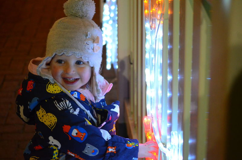 Imogen loving the Christmas lights Christmas Christmas Lights The Joy Of Christmas Cheerful Child Childhood Close-up Cute Elementary Age Girls Happiness Headwear Home Interior Leisure Activity Lifestyles Looking At Camera One Person People Playing Portrait Real People Smiling Fresh On Market 2018