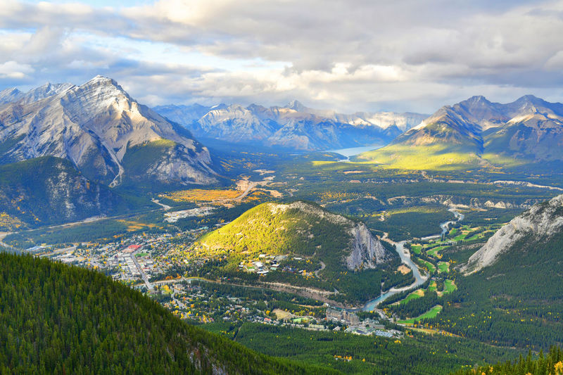 View over the town of Banff and the Canadian Rockies seen from Sulphur Mountain.You can go to the mountaintop with a gondola. Mountain Beauty In Nature Scenics - Nature Mountain Range Cloud - Sky Sky Tranquil Scene Environment Landscape Tranquility Nature Non-urban Scene Idyllic No People Plant Land Outdoors Snow Mountain Peak Snowcapped Mountain Sulphur Mountain Mountaintop Banff  Alberta Canada Rocky Mountains
