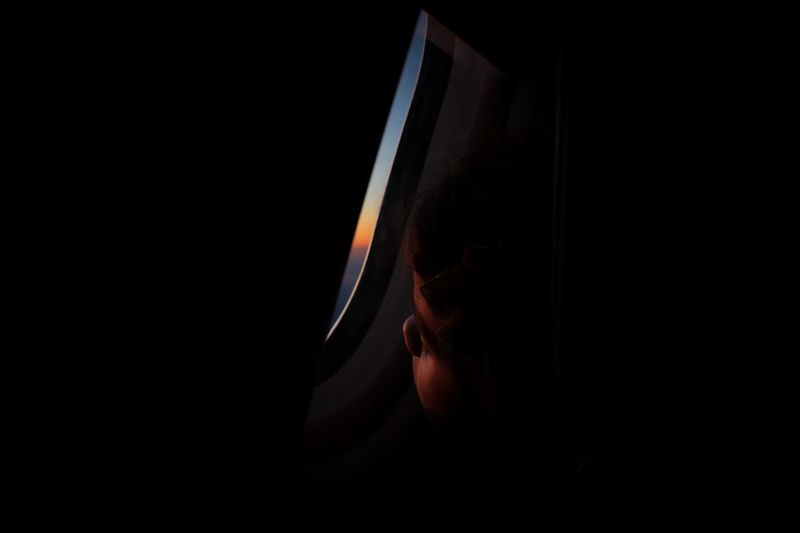 Beginnings Flying Vacations Transportation Traveling Travel Sunset Looking Through Window Airplane Window Airplane Window One Person Human Body Part Adult Portrait Looking Headshot My Best Photo