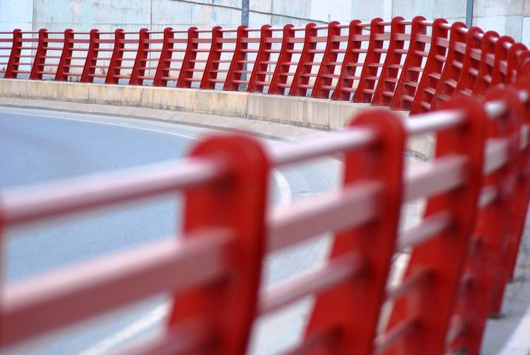 View Of Red Railing On Curve Of Road