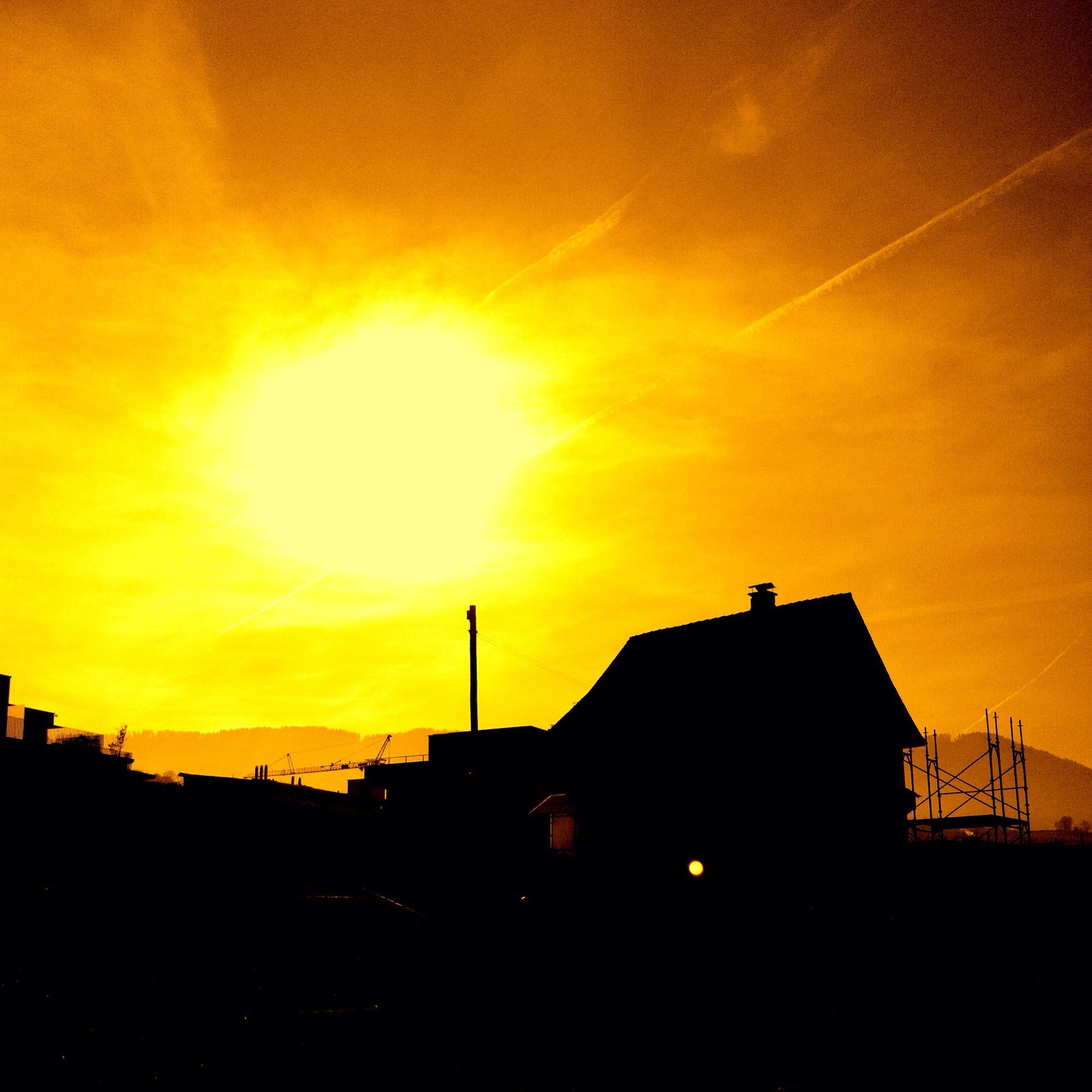 sunset, silhouette, orange color, architecture, built structure, building exterior, sky, low angle view, sun, city, yellow, building, dramatic sky, outdoors, beauty in nature, industry, scenics, nature, no people, cloud - sky