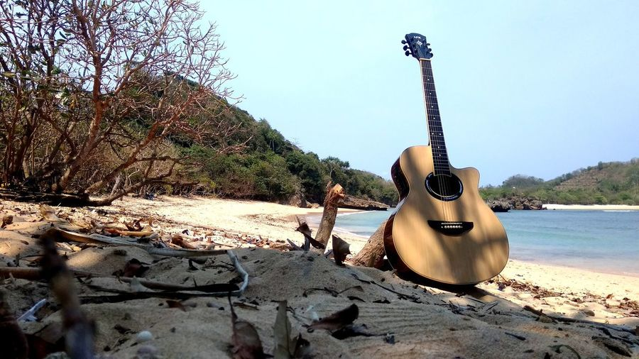 Music Nature Beach Sand Music On The Beach Guitar Musical Instrument Electric Guitar Beach Music Sand Arts Culture And Entertainment Sunlight Sky Acoustic Guitar Calm First Eyeem Photo EyeEmNewHere