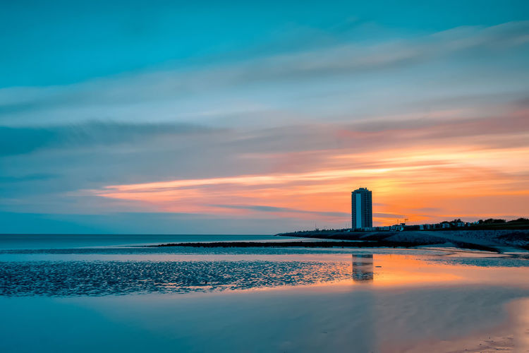 Büsum an der Nordsee Büsum Sky And Clouds Sunset_collection Architecture Beach Beauty In Nature Building Exterior Built Structure Cloud - Sky Day Deichhausen Lighthouse Nature No People Ocean Outdoors Scenics Sea Sky Skyscraper Sunset Tranquil Scene Tranquility Water