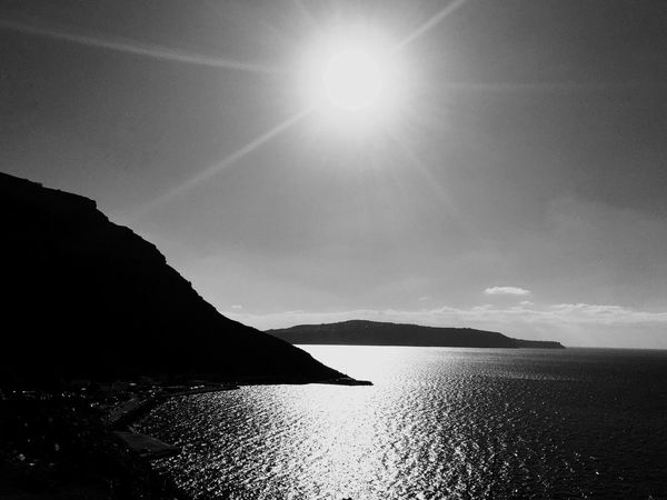 Water Tranquility Sun Scenics Beauty In Nature Sea Nature Tranquil Scene Sky No People Mountain Sunlight Outdoors Day Horizon Over Water Blackandwhite